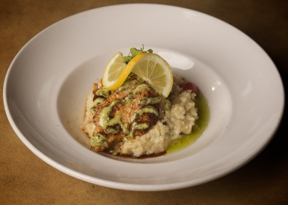 Auction fresh catch over mushroom risotto